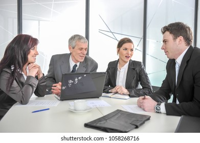 Group of business people discussing at meeting