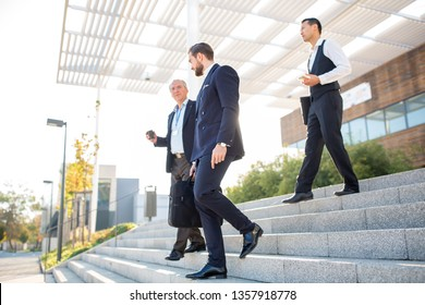 Group of business people in front of an office building