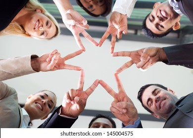 group business people hands forming a star shape