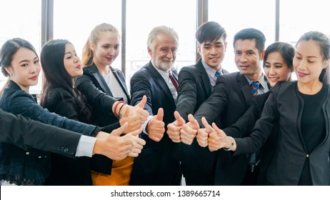 Group of Business People Hands Together Thump up at indoor office. Team Work Business Concept.