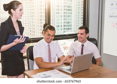 Group of business people happy creative team talking in modern office .Business team sharing their ideas.Happy smiling and laughing