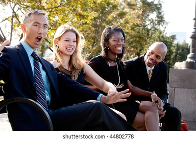A group of business people having fun and joking