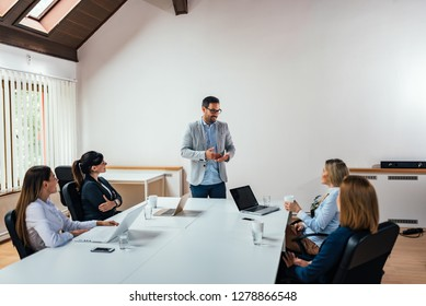Group of business people having a meeting in boardroom. Copy space.