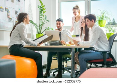 Group of business people having meeting together in the office.