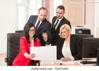 Group of Business People Having Meeting Together in the Office