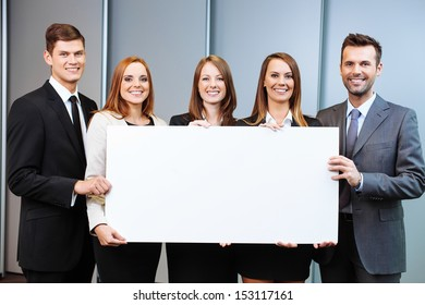 Group of business people holding billboard in the office