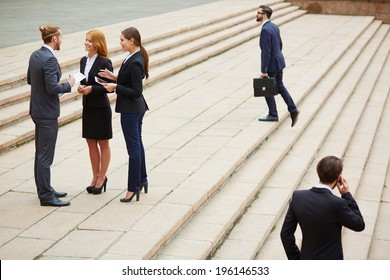 Group of business people interacting outside