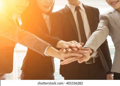 Group of business people joining hand together for making a deal