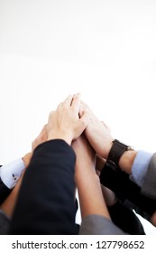 Group of business people joining hands together isolated.