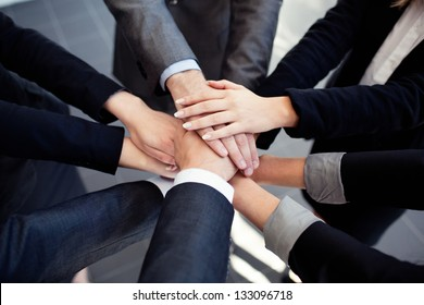 Group of business people joining hands.