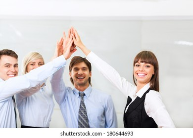Group of business people joining hands together, collaboration team at office meeting, businesspeople smile leader hold pile of hands, concept of colleagues working together cooperation