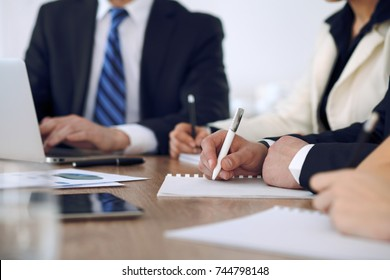 Group of business people or lawyers  at meeting, hands close-up