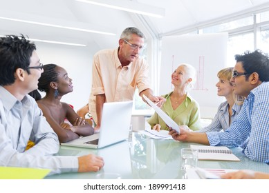 Group of Business People Learning With the Help of Their Mentor