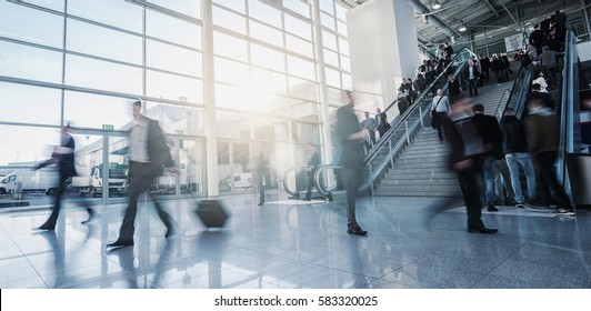 group of business people in the lobby of a trade fair