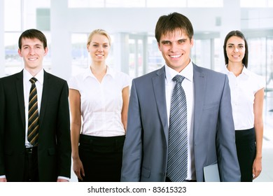 Group of business people looking at camera