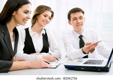 Group of business people looking at monitor