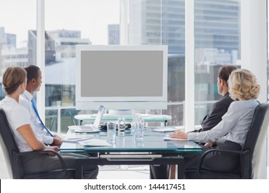 Group of business people looking at a screen during a video conference
