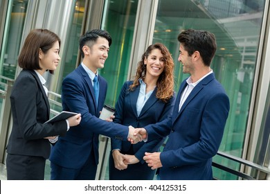 Group of business people make a deal
