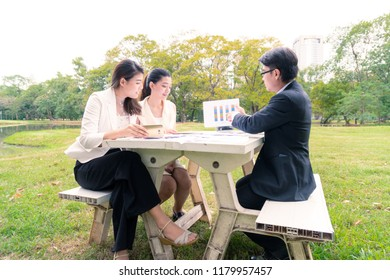 Group of business people meet and make a deal and showing thumb up in the garden.