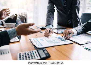 Group of business people meeting analyzing financial documents at meeting