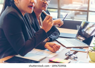 Group of business people meeting in conference room brainstorming consult business document graph chart office desk. Diversity multiethnic group of business people brainstorming and working together.