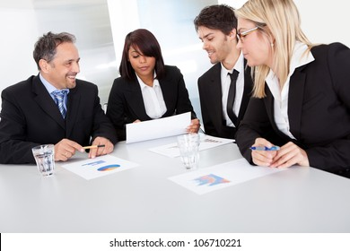 Group of business people at the meeting discussing