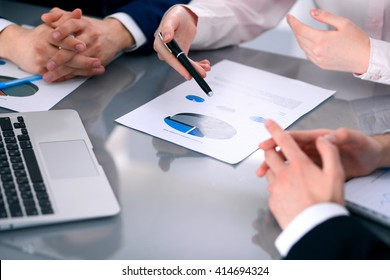 Group of business people at meeting  discussing financial results