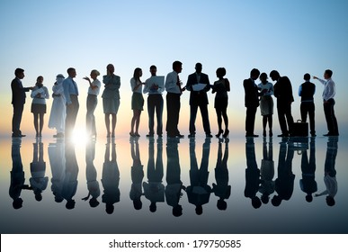 Group of Business People Meeting with Sunset