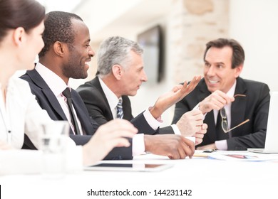 Group of business people meeting at table
