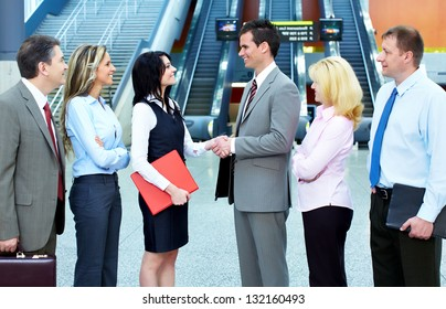 Group of business people in a modern hall. Meeting.