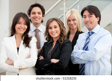 Group of business people at the office smiling