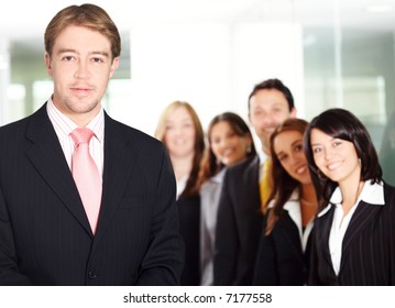group of business people - office team formed by young and successful businessmen and businesswomen in an office environment