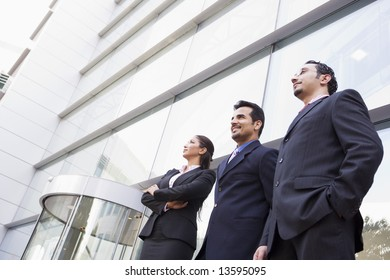 Group of business people outside modern office