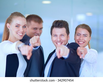 Group of business people pointing to you
