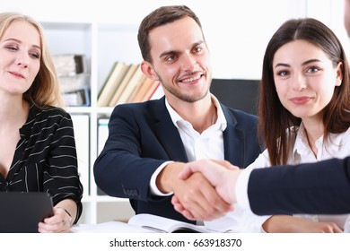Group business people shake hands as hello in office closeup. Friend welcome, introduction, greet or thanks gesture, product advertisement, partnership approval, arm, strike a bargain on deal concept