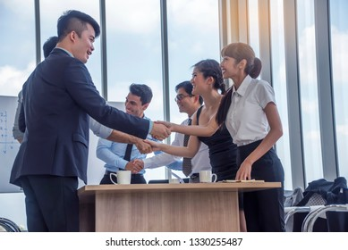 Group of Business people shakes hands, congratulating Or introduce yourself before the meeting at office .Coworker,meeting concept.