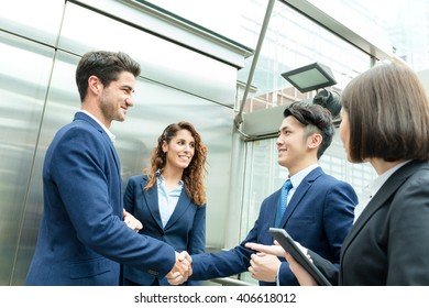 Group of business people shaking hand