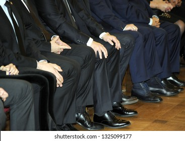 Group of business people sitting at conference meeting