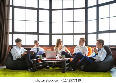 Group of business people sitting in an informal atmosphere.