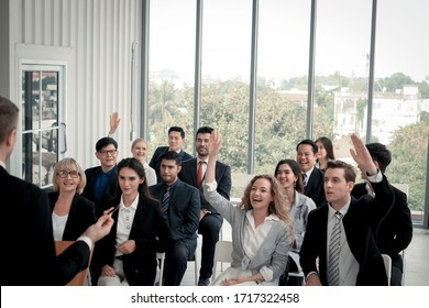 Group of business people sitting on conference together listening to the speaker giving a speech in the meeting room seminar, The talker motivating, cheer up and giving inspires people