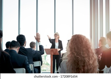 Group of business people sitting on conference together listening to the speaker giving a speech in the meeting room seminar, The talker motivating, cheer up and giving inspires poeple