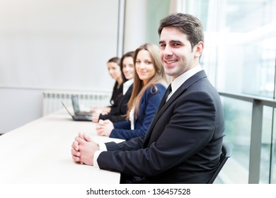 Group of business people smiling at the office lined up