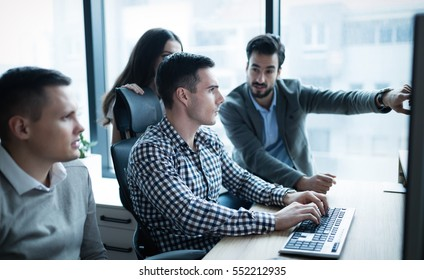 Group of business people and software developers working as a team in office