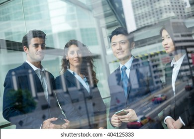 Group of business people standing inside office building