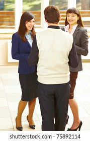 Group of business people standing in office and discussion something