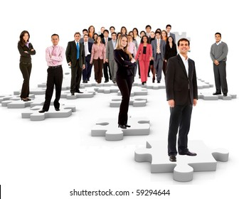 Group of business people standing on the pieces of a puzzle - isolated over a white background