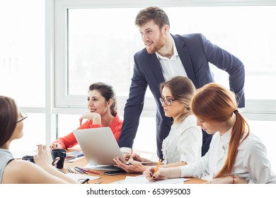 Group of business people supporting dancing female colleague