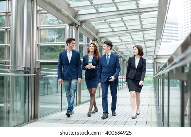 Group of business people talk to each other