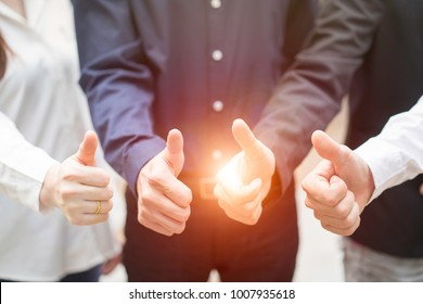 Group of business people with thumbs up. Business, success, teamwork concept