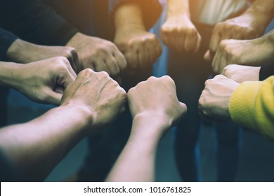 Group of business people united hands together - teamwork concepts,Image of hands in circle as symbol of their partnership and teamwork,we will do the best concept.